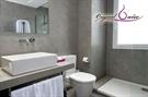 Imagen de la categoría Ideas para baños. Decorar un baño moderno con microcemento y piedra natural.